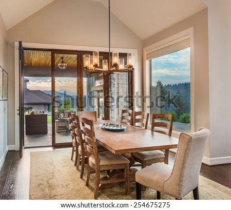Dining Room in New Luxury Home with View of Patio and Colorful Sky