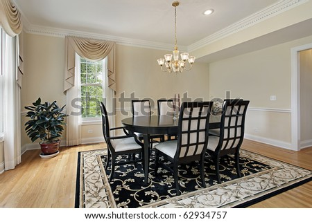 Dining room in suburban home with black table - stock photo