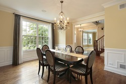 Dining room in suburban home with foyer view