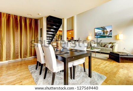 DIning room interior in modern city apartment with high loft ceiling.