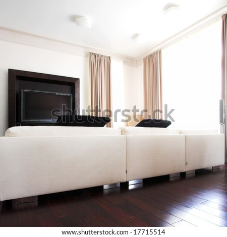Dining room interior with white sofa, tv