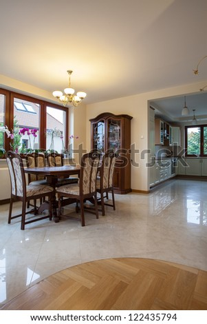 Dining room, kitchen, corridor in traditional beige house