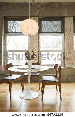 Dining room table and chairs in a modern loft setting. Vertical shot.