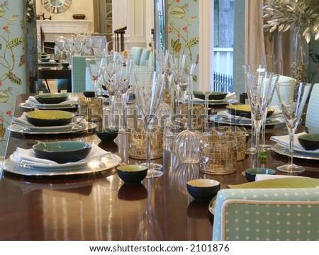 Dining room table elegantly set.