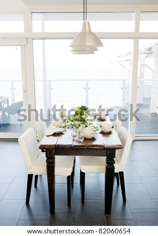Dining room table with chairs.