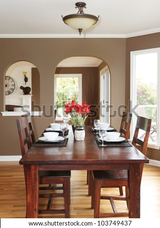 Dining room with brown walls and wood table in the luxury home. #103749437
