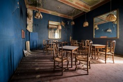 dining room with chairs and tables in abandoned restaurant bar. High quality photo