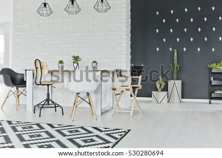 Dining room with chalkboard and decorative brick wall