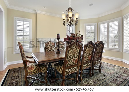 Dining room with fireplace and cream colored walls