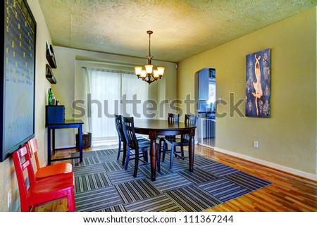 Dining Room With Green Walls, Black Table And Grey Rug With Art ...