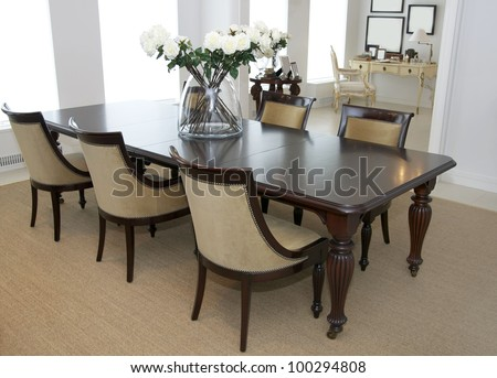 dining room with large table and comfortable chairs