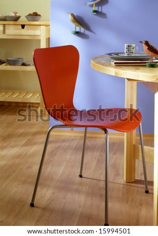 dining room with red chair