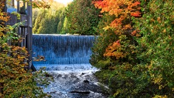 Dining room with the view of the waterfall in autumn.