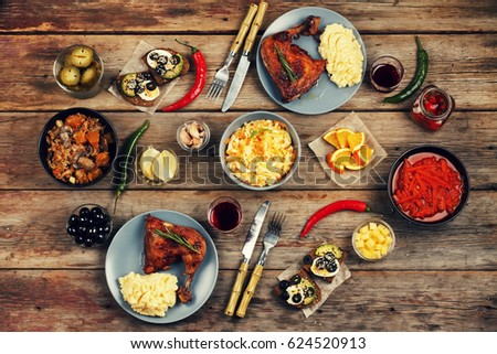 Dining table. A variety of food on a wooden table. View from above, rustic style