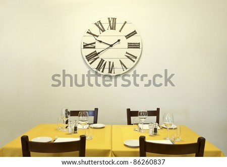 dining table and clock on the wall