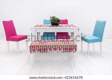 dining table and comfortable chairs in modern home with elegant table setting #423616678