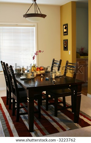 Dining table and plates on a dining table (note: pics on the wall are mine)