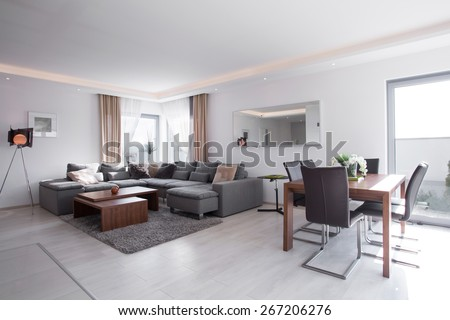Dining table in bright exclusive living room #267206276
