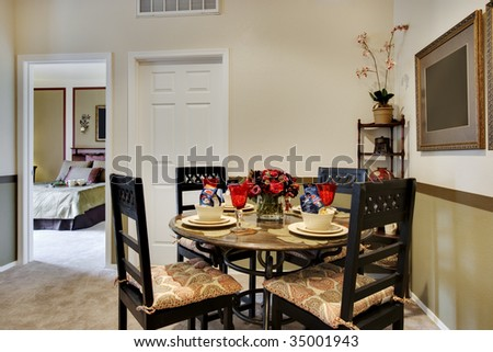 Dining table next to kitchen area - stock photo