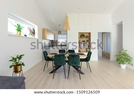 Dining table next to kitchen in contemporary house #1509126509