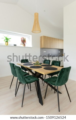 Dining table next to kitchen in contemporary house #1509126524