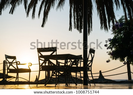 Dining table on the beach at sunrise background #1008751744