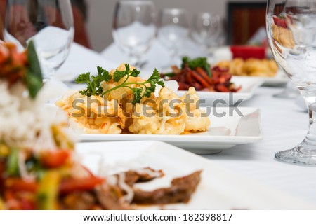 dining table set up with different kind of dishes