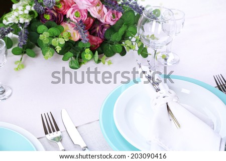 Dining table setting with lavender flowers on table, close-up. Lavender wedding concept
