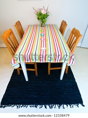 dining table with a colorful tablecloth