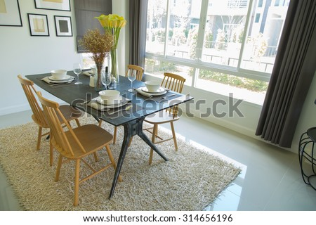 Dining table with set in modern home, Wooden table in Dining room, Luxury corner in the family.