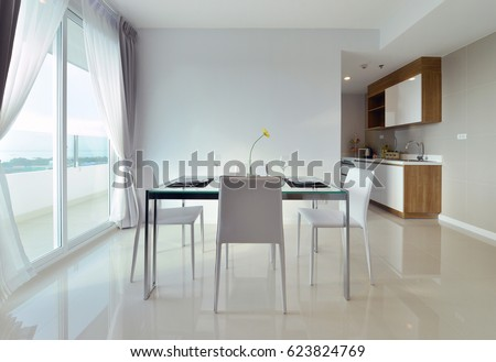 dining table with table set in white luxury modern living interior and decoration, interior design