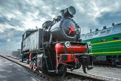 Dinkey Black train. A small train in retro style.