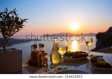 Dinner for two and the sea sunset in Santorini, Greece