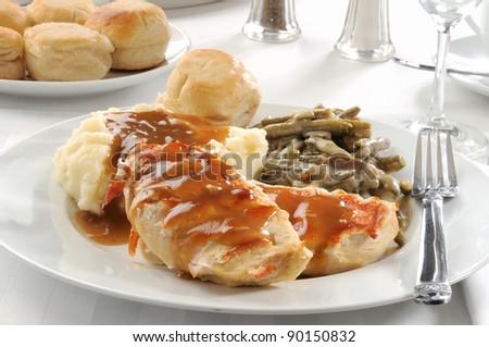 Dinner of grilled chicken breasts with mushroom gravy
