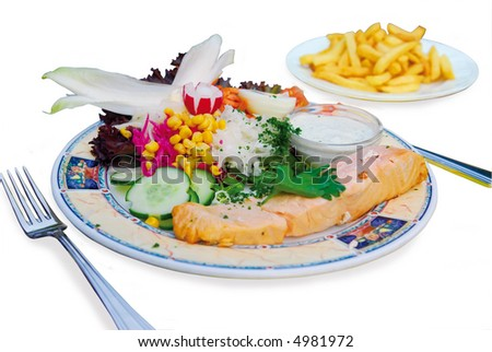 dinner of poached salmon with mixed salad and french fries isolated on white background