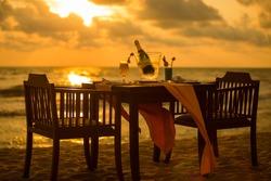 Dinner on the beach on sunset time