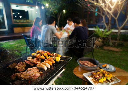 Dinner party, barbecue and roast pork at night #344524907