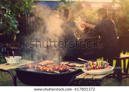 Dinner party, barbecue and roast pork at night  #617801372