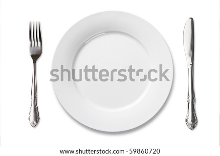 Dinner place setting. A white china plate with silver fork and knife isolated on white background.