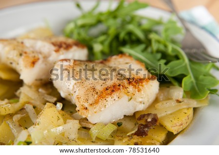Dinner Plate with Fried Potatoes and Grilled Cod with Side of Fresh baby Arugula