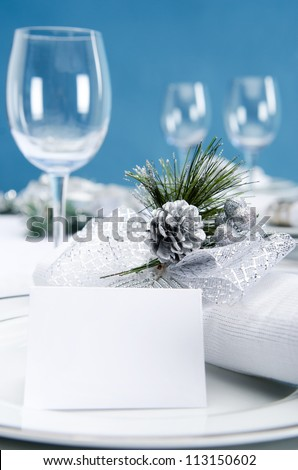 Dinner service christmas table place plate setting with empty name card in cool silver icy theme