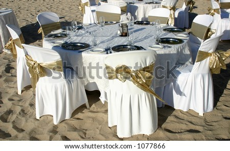 stock photo Dinner table at a beach wedding