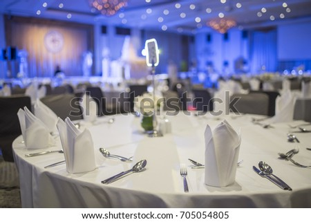 Dinner table in the banquet room of a luxury hotel. - Shutterstock ID 705054805