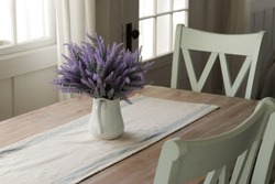 dinning table with lavender flowers in a vase