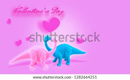 Dinosaur model On a beautiful color background Have a heart of love #1282664251