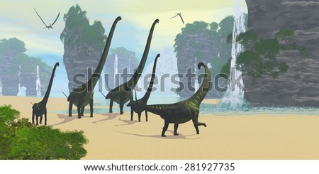Dinosaur Seashore - A Mamenchisaurus dinosaur herd comes down to a lake for a drink of water with two Pteranodon flying reptiles hunting for fish.