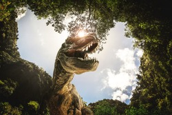 dinosaur , T-rex   with tree branches against on the nature .