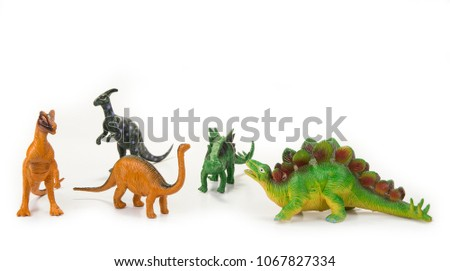 Dinosaur toy with open mouth on the white #1067827334
