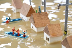 Diorama landscape of houses flooded by floods and people waiting for rescue
