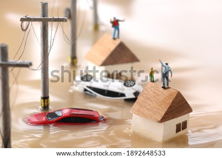 Diorama landscape of houses flooded by floods and people waiting for rescue Foto stock ©